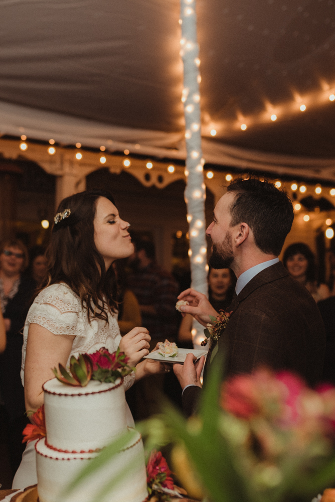 Twenty Mile House Wedding, couple feeding each other cake photo