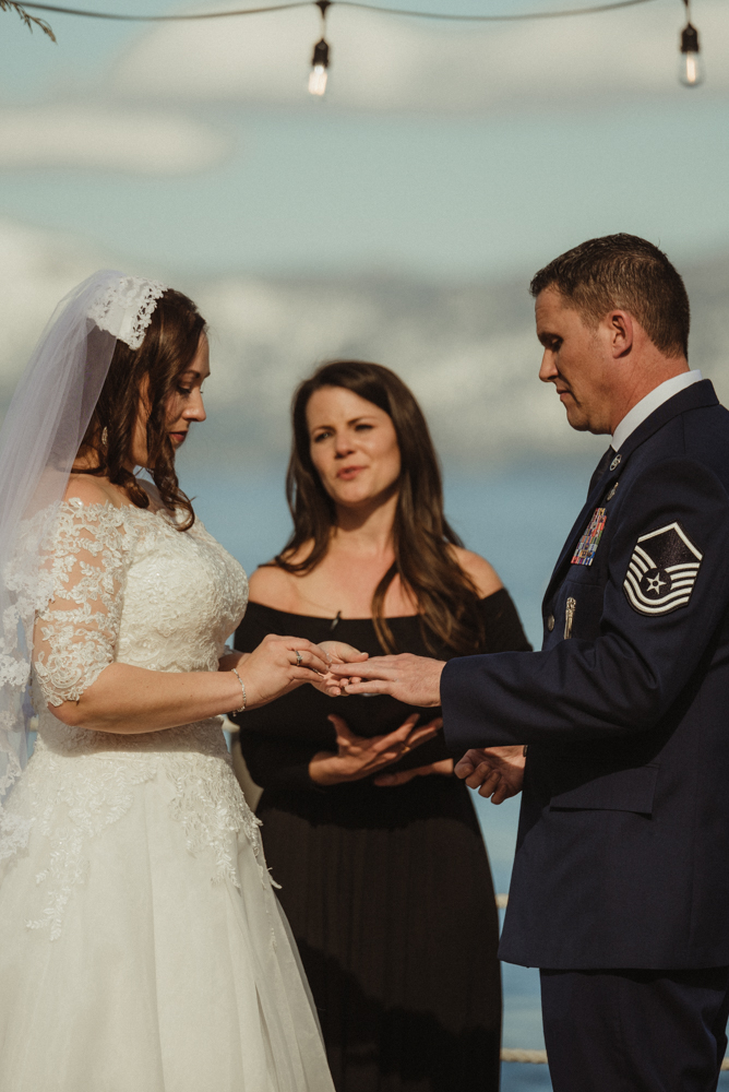 West Shore Cafe Wedding, bride exchanging rings photo
