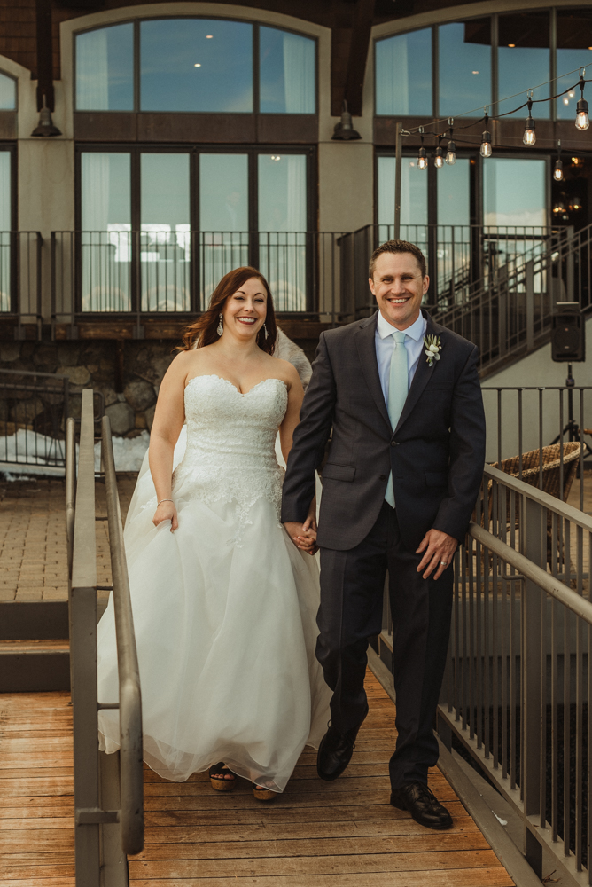West Shore Cafe Wedding, couple holding hands and walking photo
