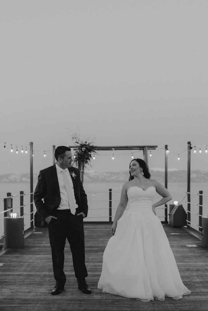 West Shore Cafe Wedding, couple standing on a dock in lake tahoe photo
