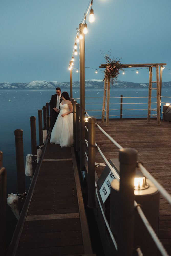 West Shore Cafe Wedding, couple walking on a narrow dock in lake tahoe photo