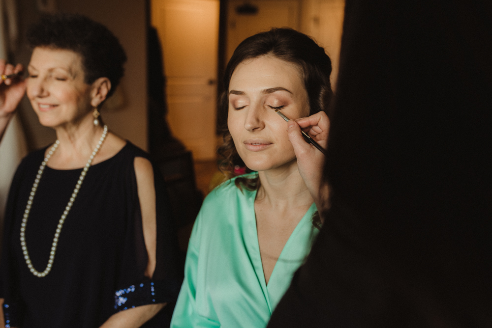 Emerald Bay Elopement, bride getting her makeup done with her mom photo