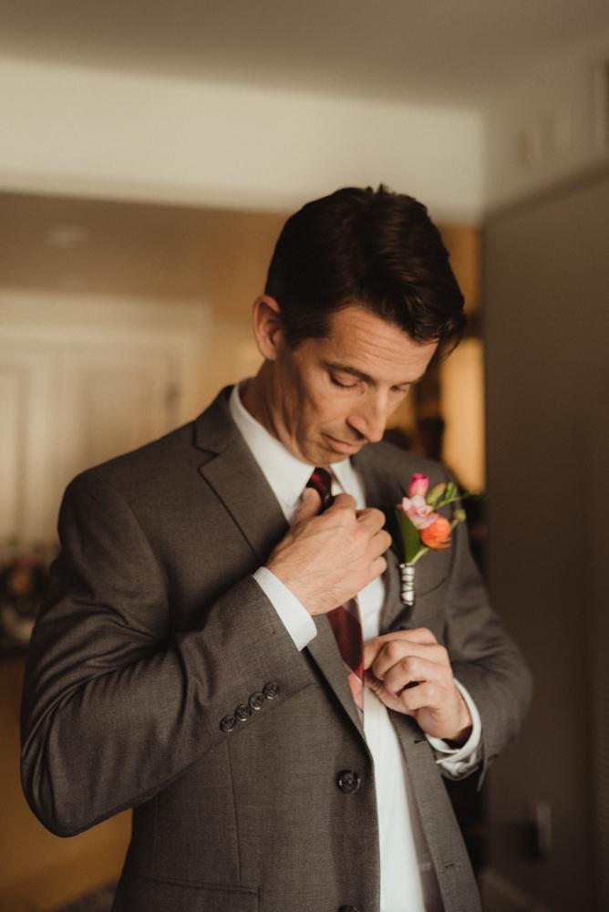 Emerald Bay Elopement, groom fixing his tie photo