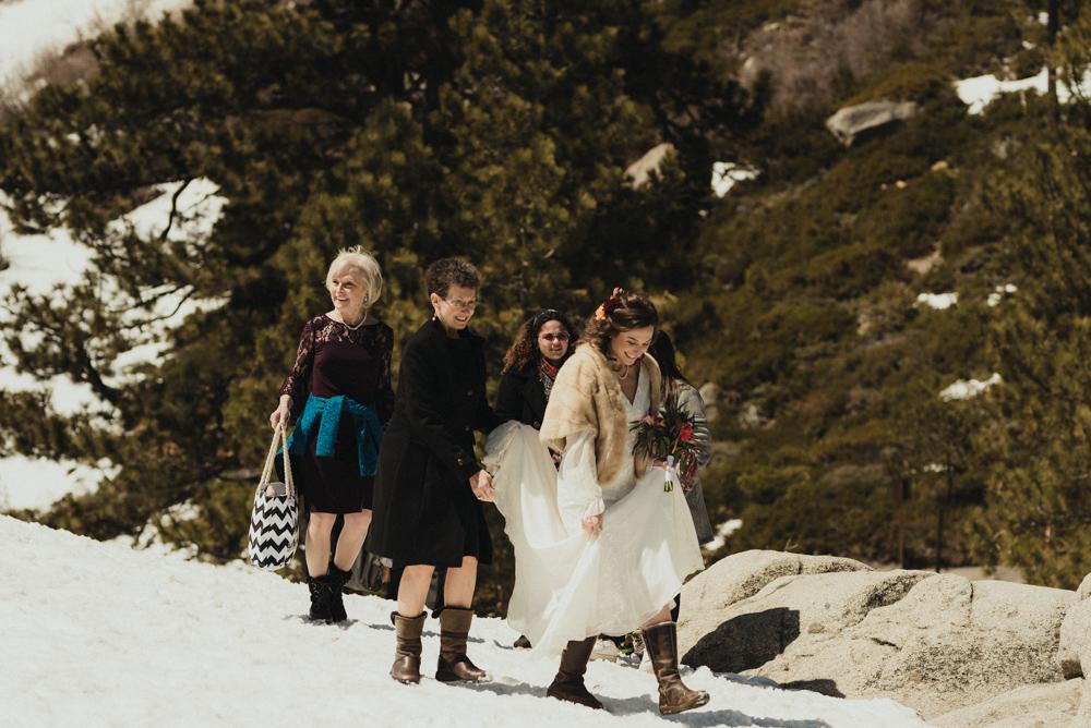 Emerald Bay Elopement, bride walking in the snow photo