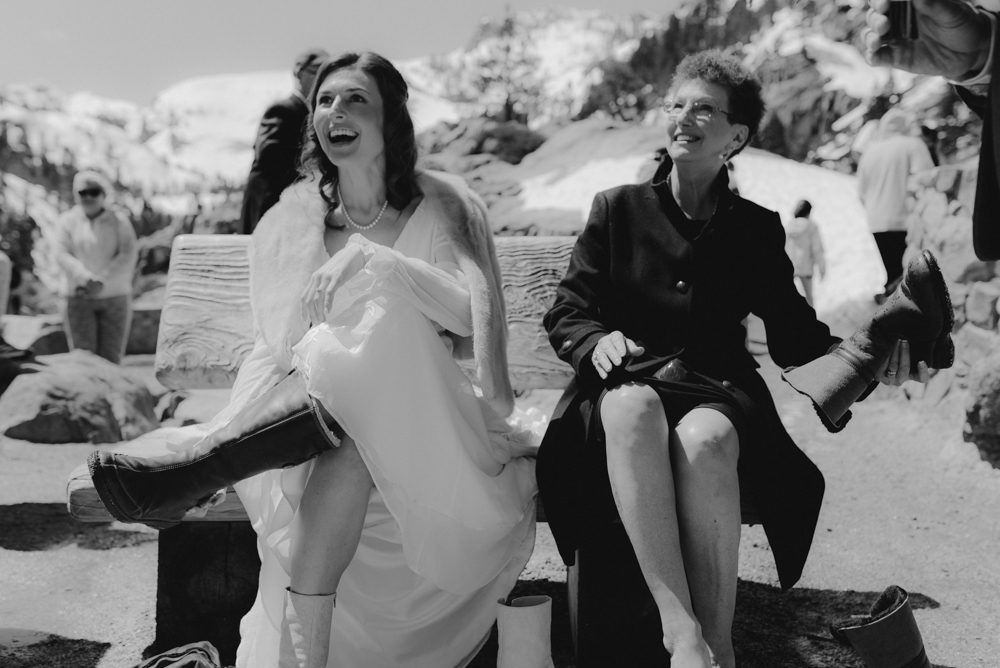 Emerald Bay Elopement, bride putting on her boots photo