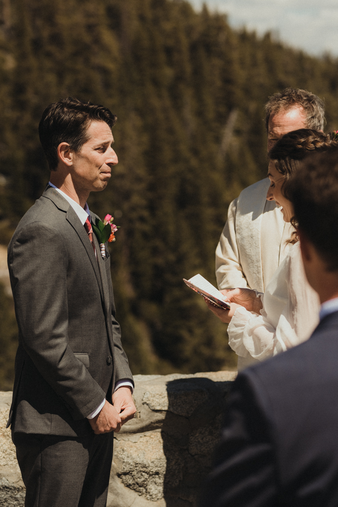 Emerald Bay Elopement, grooms reaction to vows photo