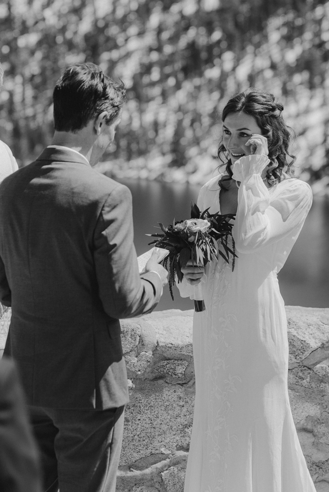 Emerald Bay Elopement, bride crying during her vows photo