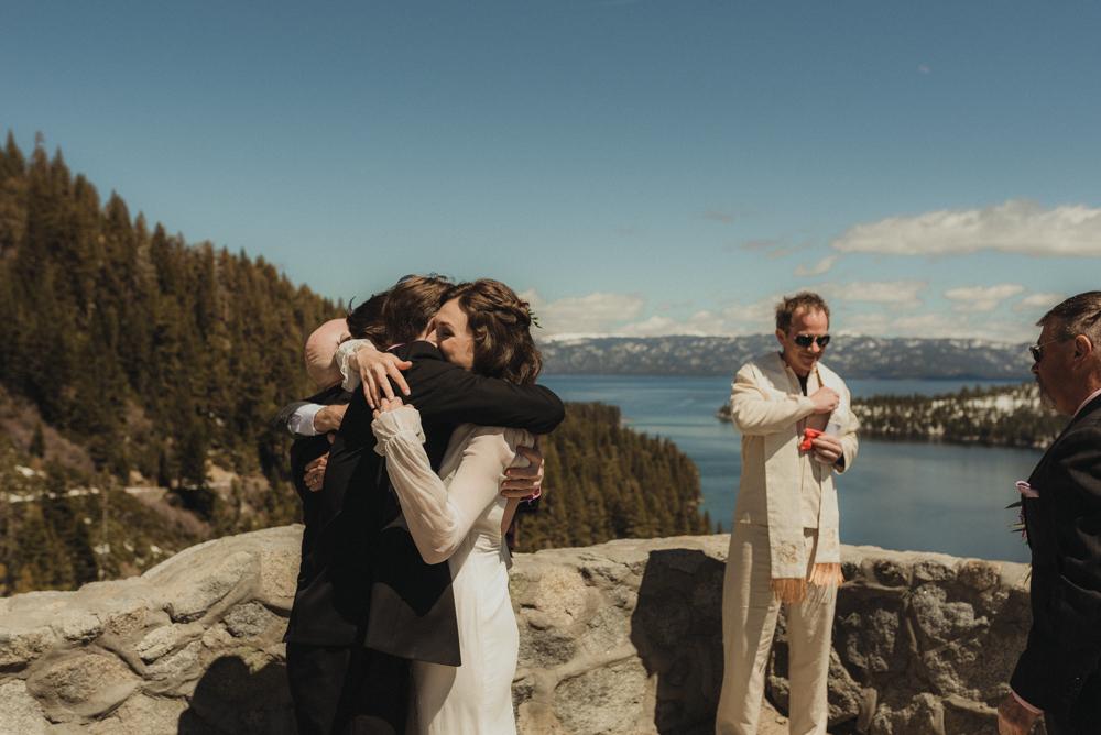 Emerald Bay Elopement, bride hugging family photo