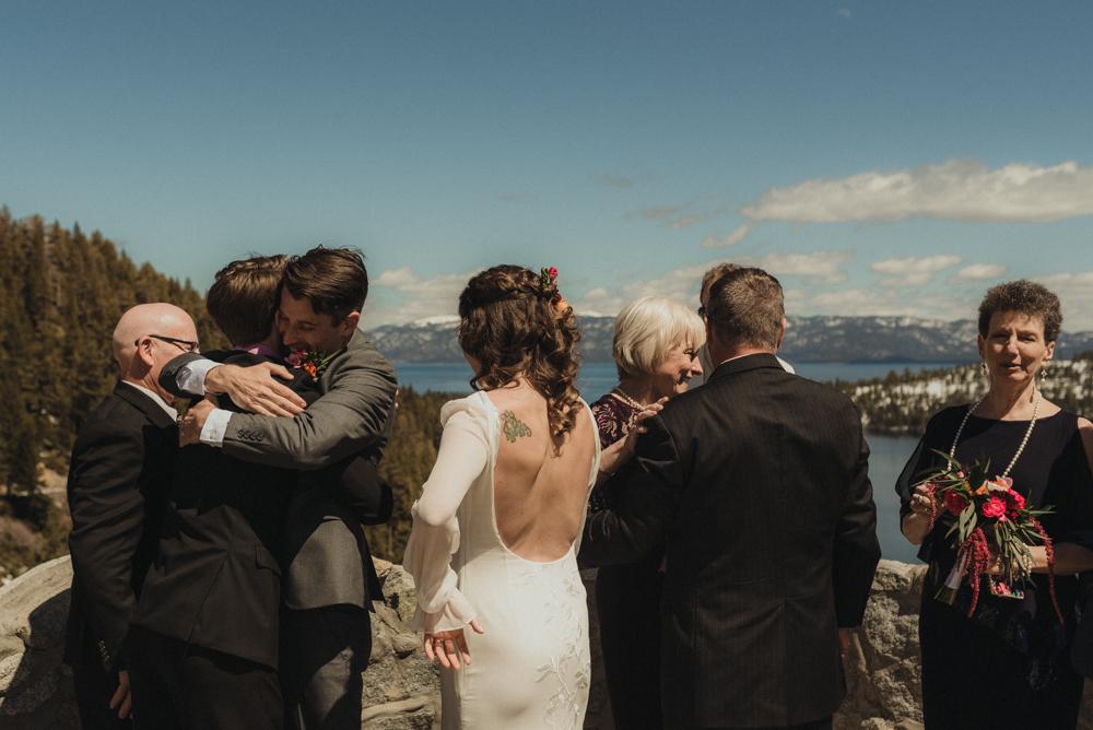 Emerald Bay Elopement, groom hugging family photo
