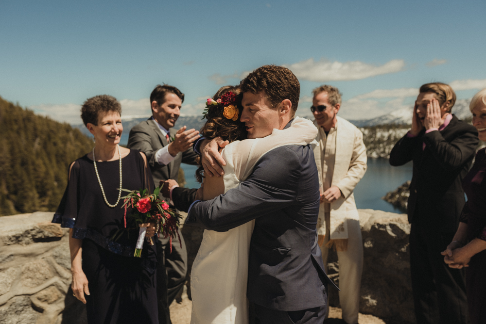 Emerald Bay Elopement, hugs after ceremony photo