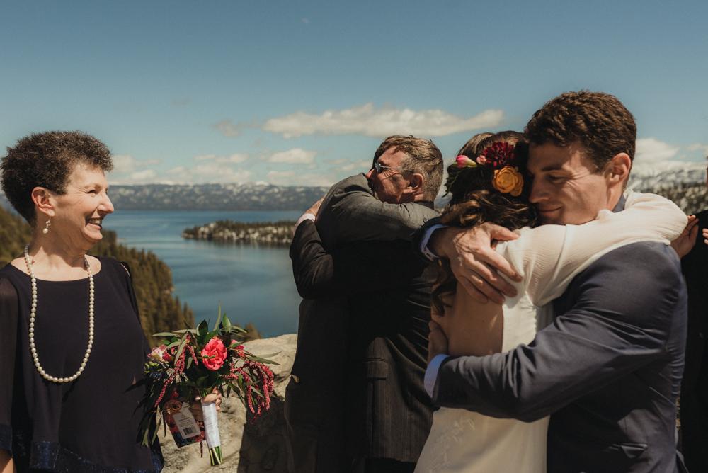 Emerald Bay Elopement,  bride hugging brother photo