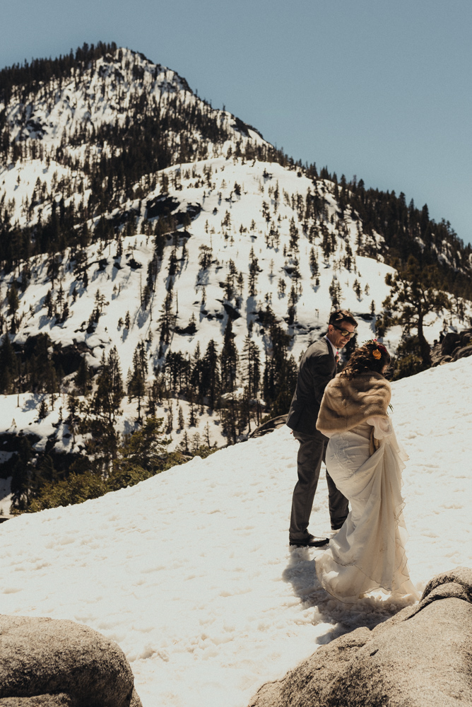 Emerald Bay Elopement couple walking in the snow in april photo