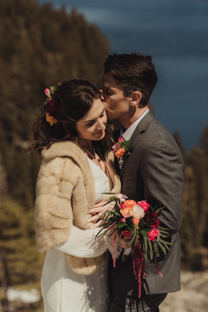Emerald Bay Elopement in April, couple kissing photo