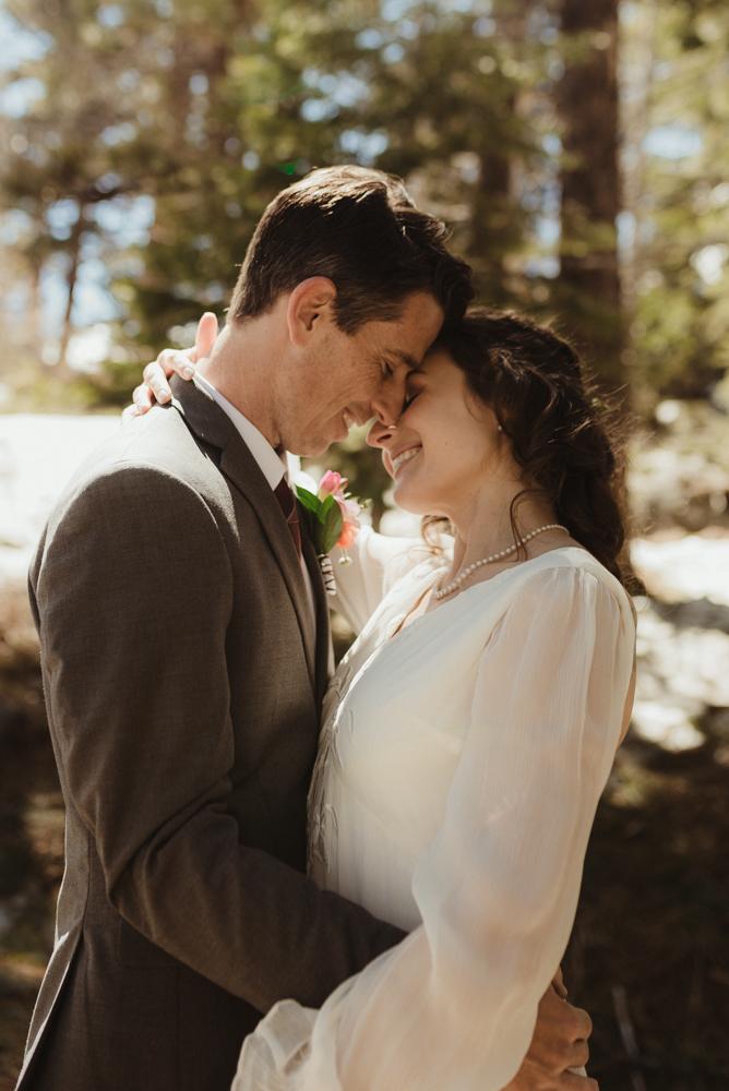 Emerald Bay Elopement in April, couple eskimo kiss photo