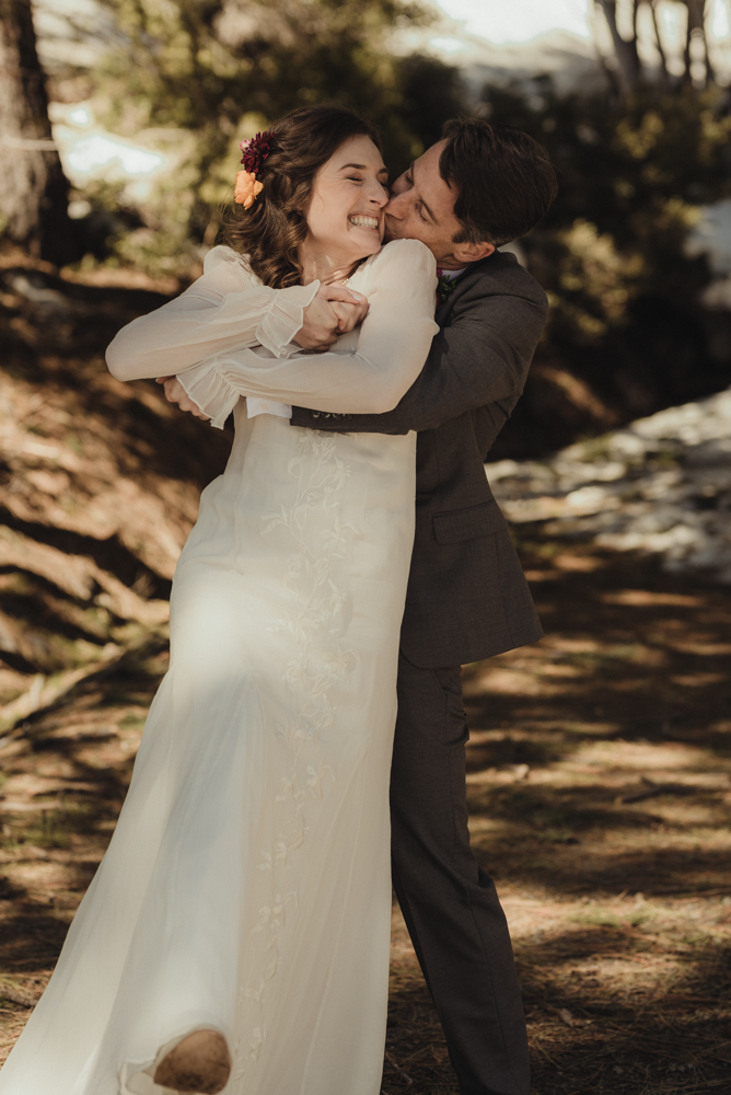 Emerald Bay Elopement in April, couple hugging photo