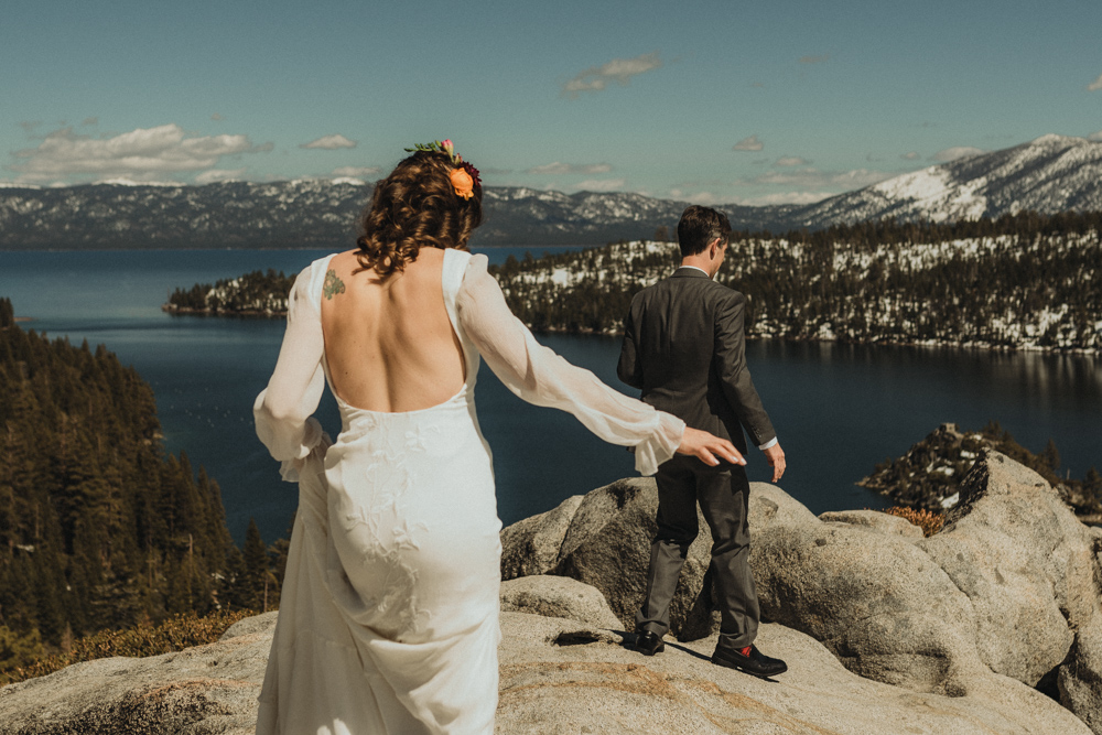 Emerald Bay Elopement in April, couple walking on the rock photo