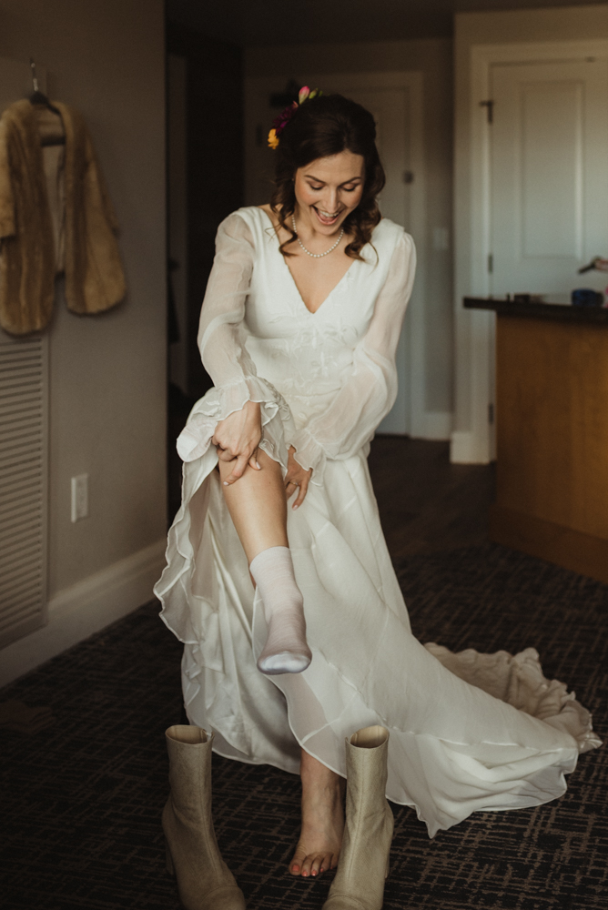bride putting on her boots photo
