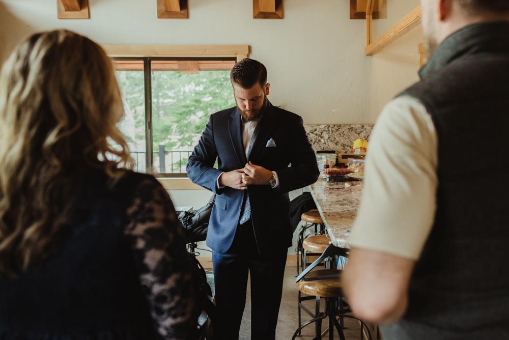 Elopement Lake Tahoe, photo of groom choosing a tie