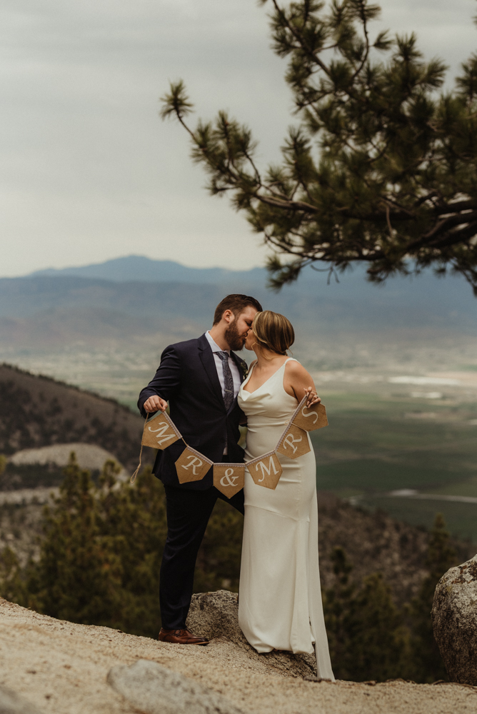 Elopement Lake Tahoe, photo of couple holding a mrs and mr sign
