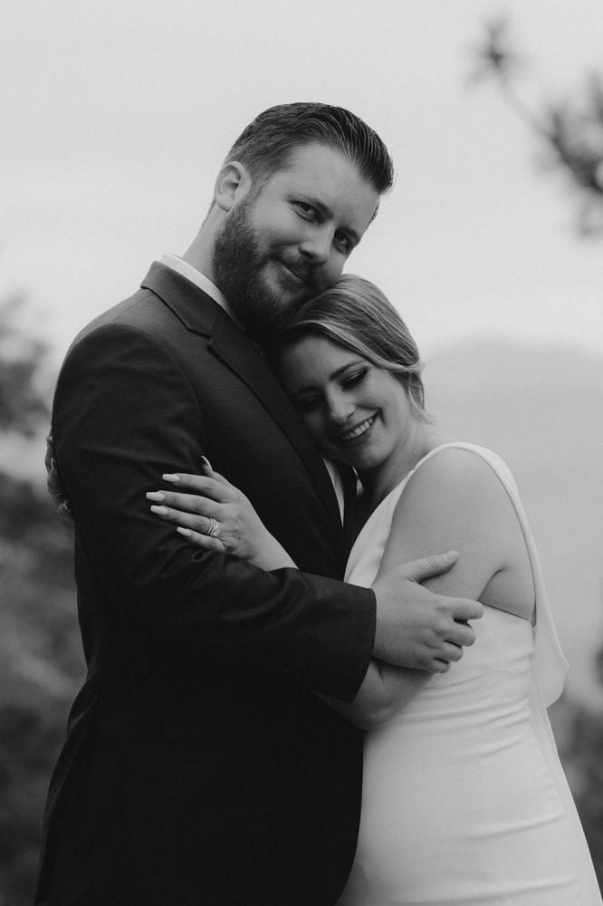 Elopement Lake Tahoe, photo of groom hugging his bride