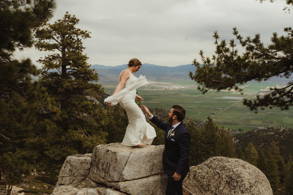 Elopement Lake Tahoe, photo of couple trying to get on a rock