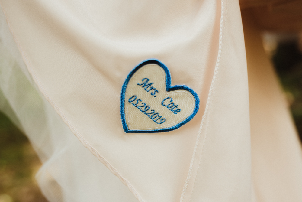 Twenty Mile House Wedding, photo of detail on wedding dress with couples last name and wedding date