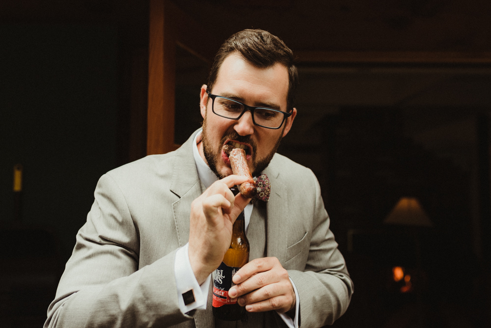Twenty Mile House Wedding, photo of groom eating a hotdog