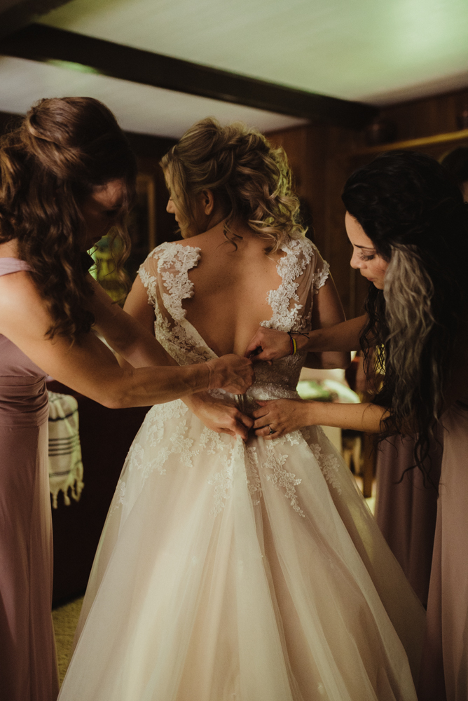 Twenty Mile House Wedding, photo of bride putting on her dress photo