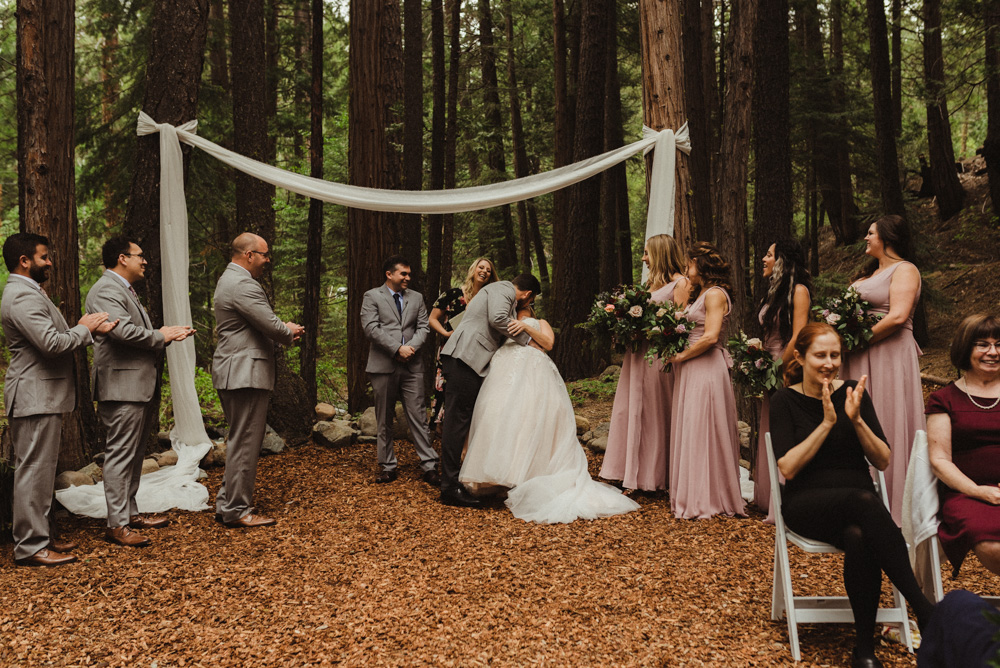 Twenty Mile House Wedding, photo of couple kissing under a white fabric arch