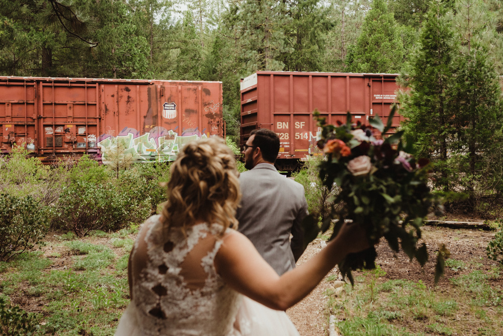 Twenty Mile House Wedding, photo of couple trying to catch the train