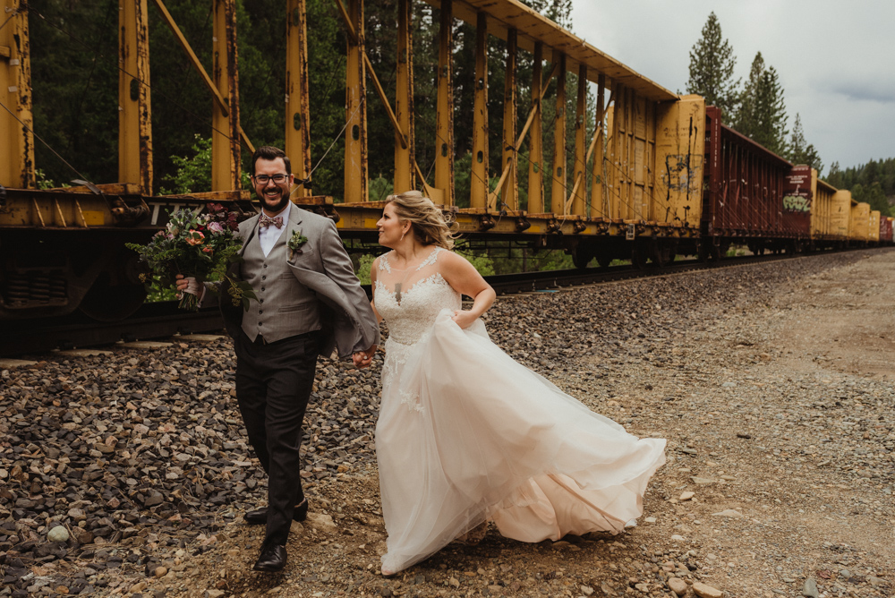 Twenty Mile House Wedding, photo of couple running by a train