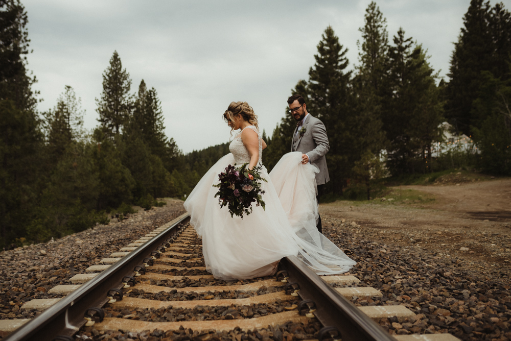 Twenty Mile House Wedding, photo of couple crossing the train tracks