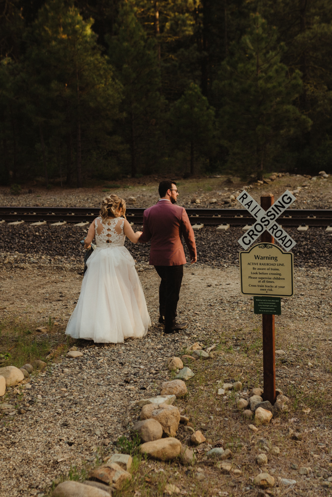 Twenty Mile House Wedding, photo of couple crossing the railroad