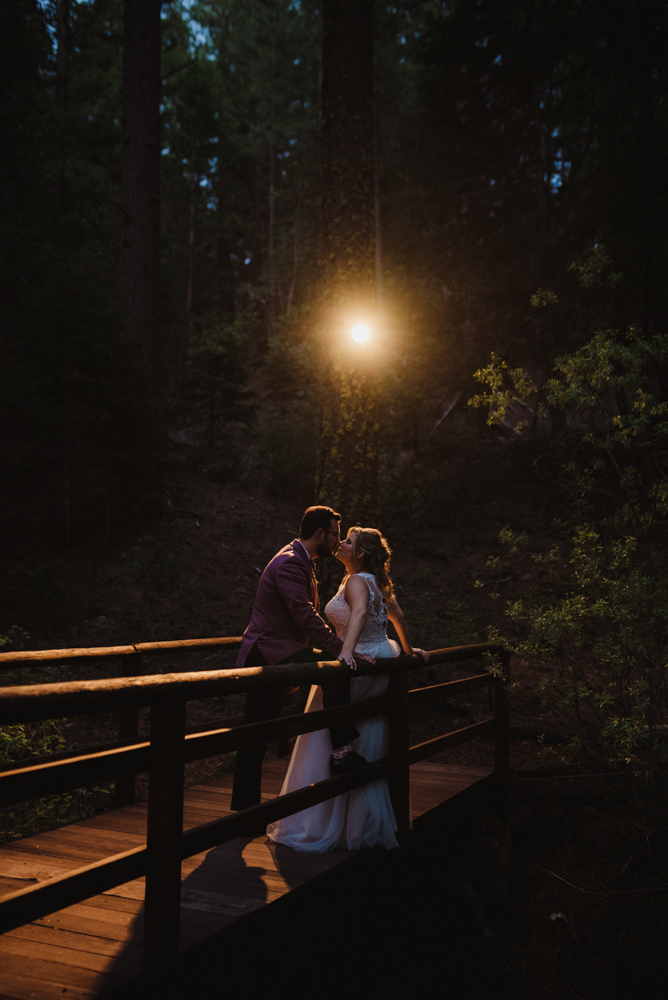 Twenty Mile House Wedding, photo of couple on a bridge at night