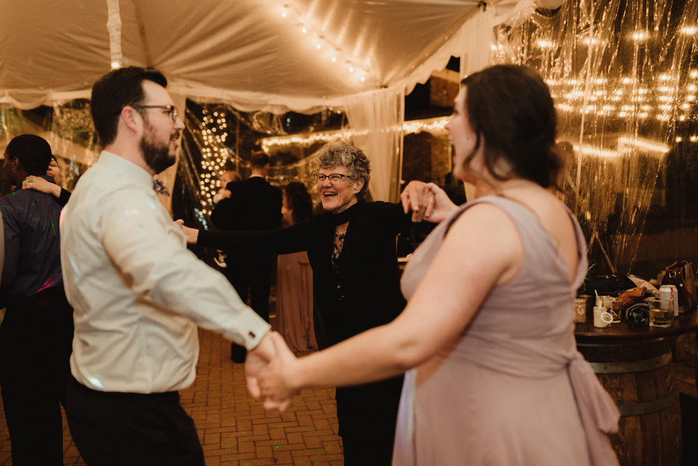 Twenty Mile House Wedding, photo of groom dancing with his sister and mom
