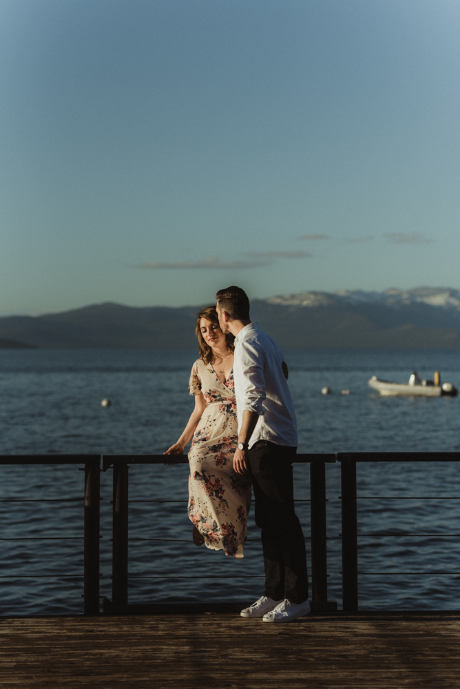 Lake Tahoe Engagement session, couple hanging out on a dock photo