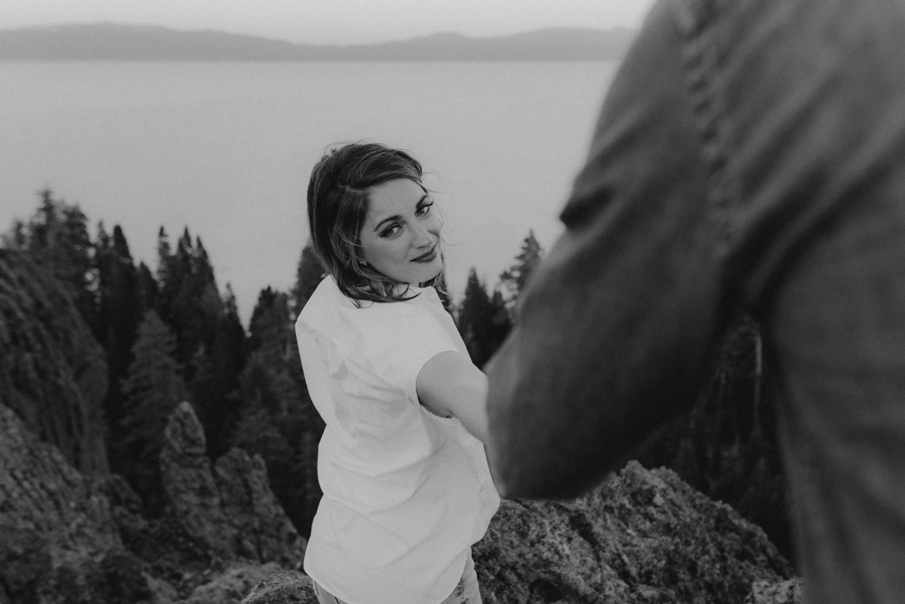 Lake Tahoe Engagement session, girl holding his hand photo