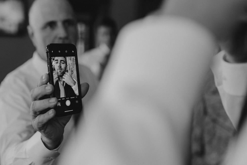 Martis Camp Wedding-using your phone as a mirror photo