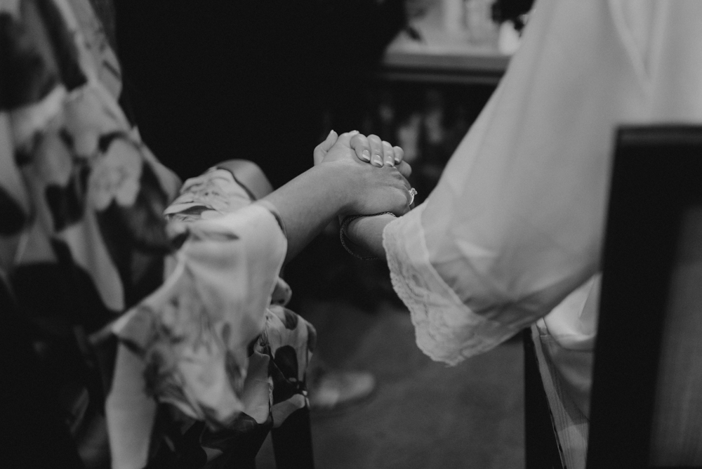 Martis Camp Wedding, bridesmaid holding brides hand photo