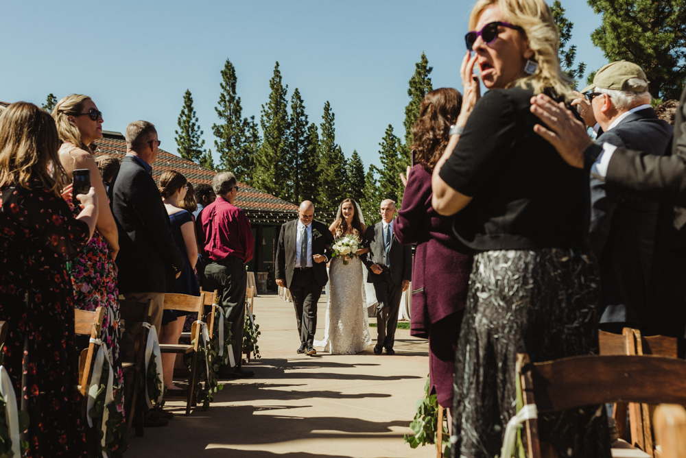 Martis Camp Wedding, bride walking down the aisle with her father and step-dad photo