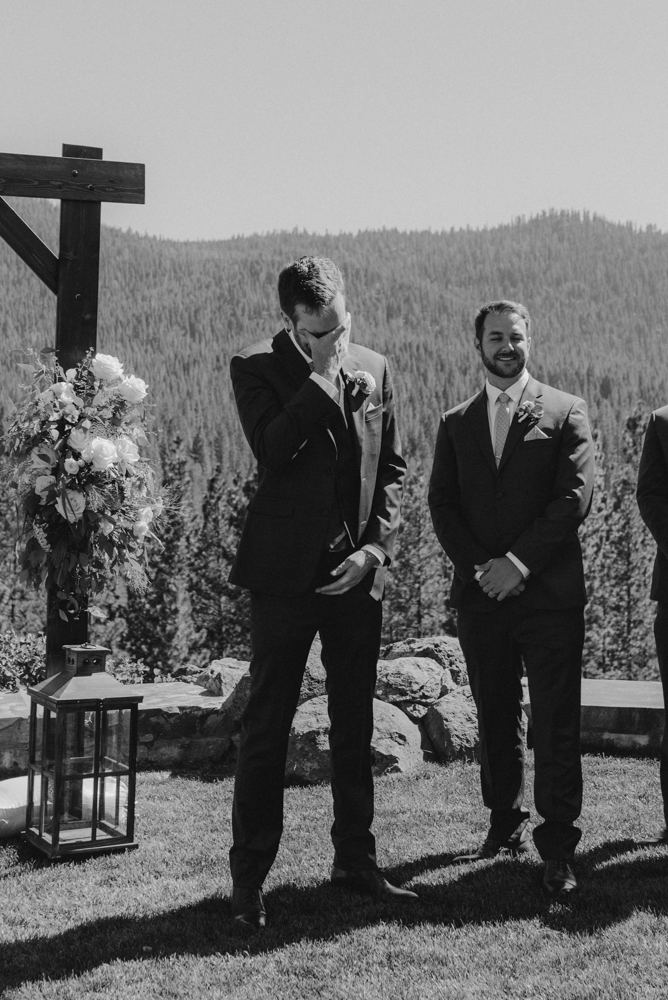 Martis Camp Wedding, groom tearing up after seeing his bride for the first time photo