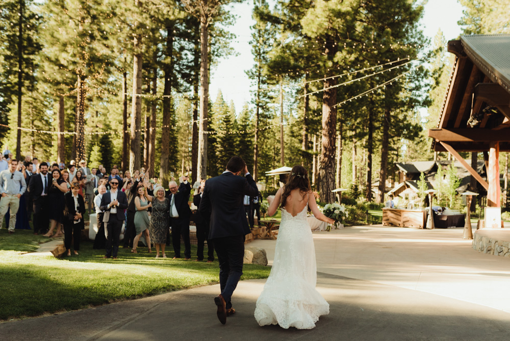 Martis Camp Wedding, couple walking in to the reception photo