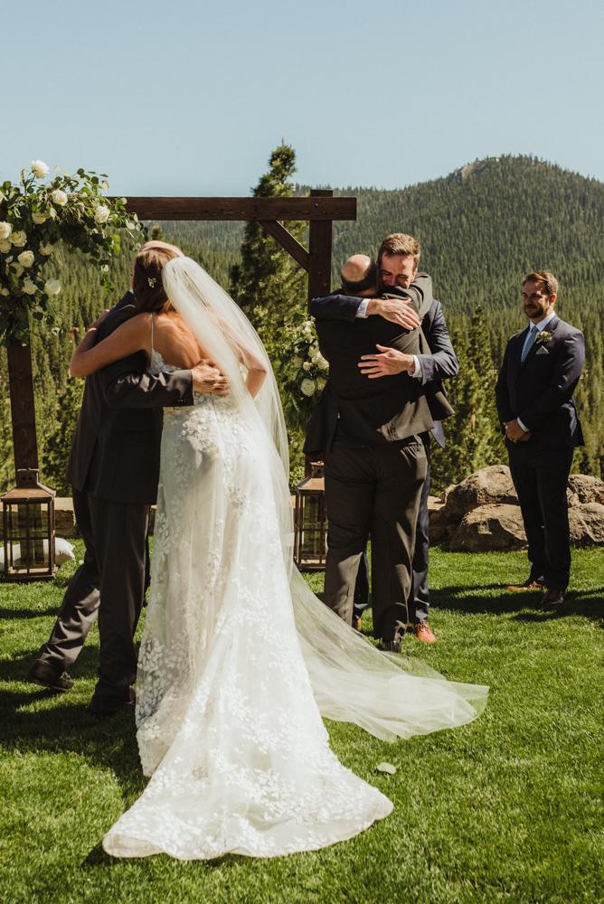 Martis Camp Wedding, couple hugging dads photo
