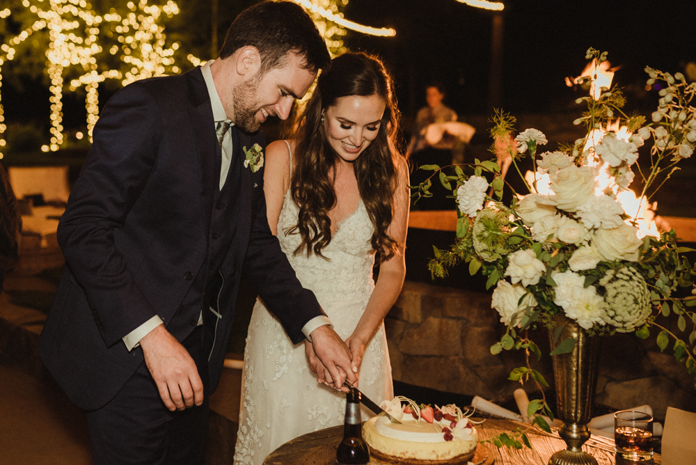 Martis Camp Wedding, couple cutting the cake photo
