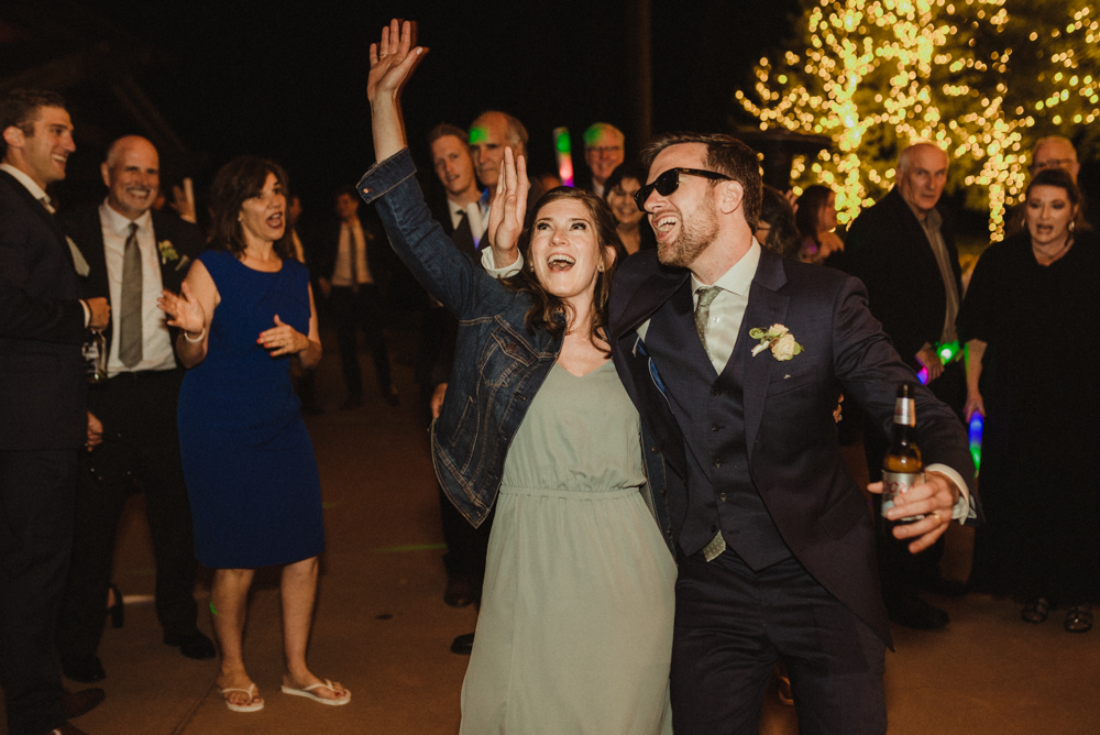 Martis Camp Wedding, groom dancing with sister photo