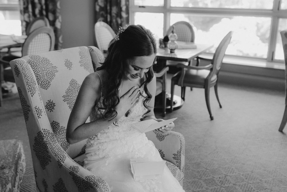 Martis Camp Wedding, bride reading a letter from the groom photo