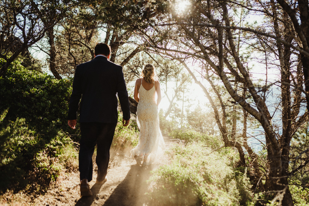 Lake Tahoe Elopement, photo of couple surrounded by sun and dustLake Tahoe Elopement, photo of couple walking down a trailLake Tahoe Elopement, photo of couple walking on a trail