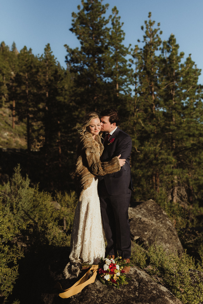Lake Tahoe Elopement, photo of couple standing on a rock overlooking Tahoe