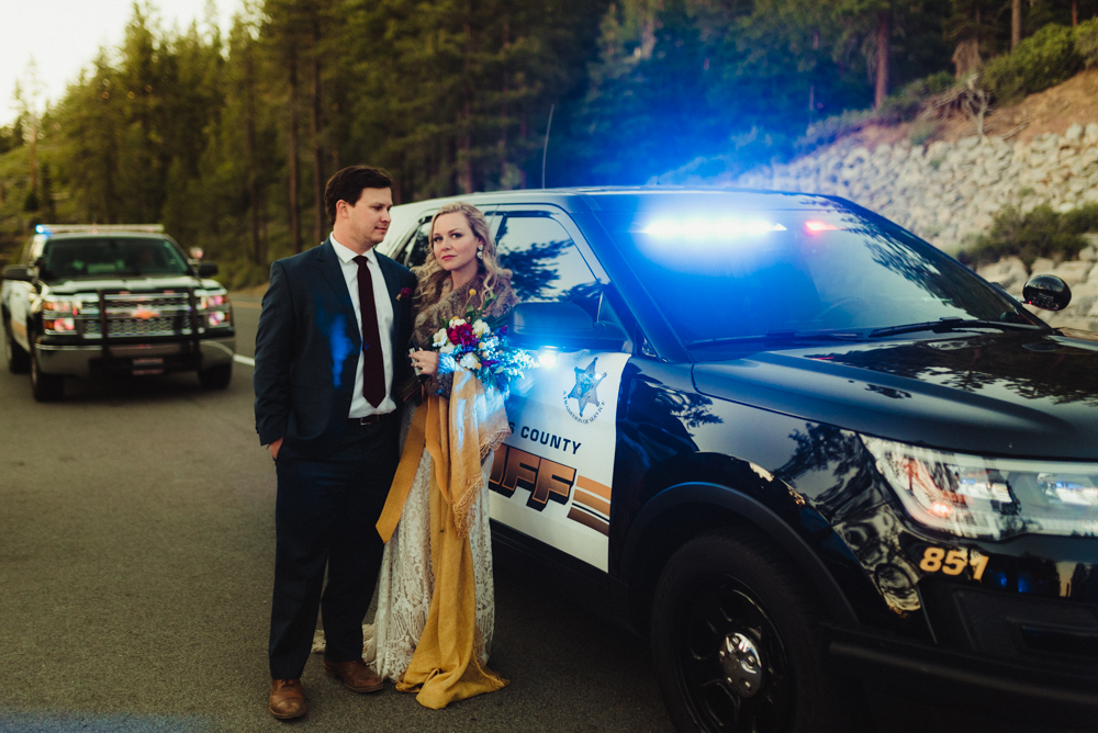 Lake Tahoe Elopement, photo of couple next to a police car