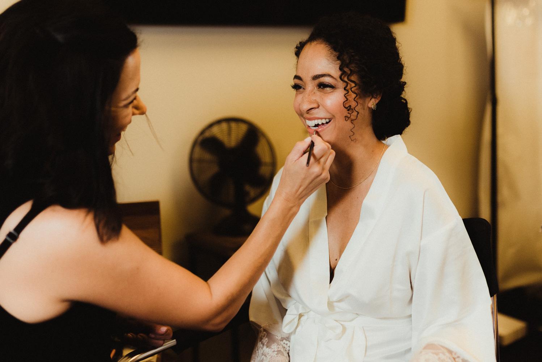 Rush Creek Lodge Wedding, photo of bride getting her makeup done